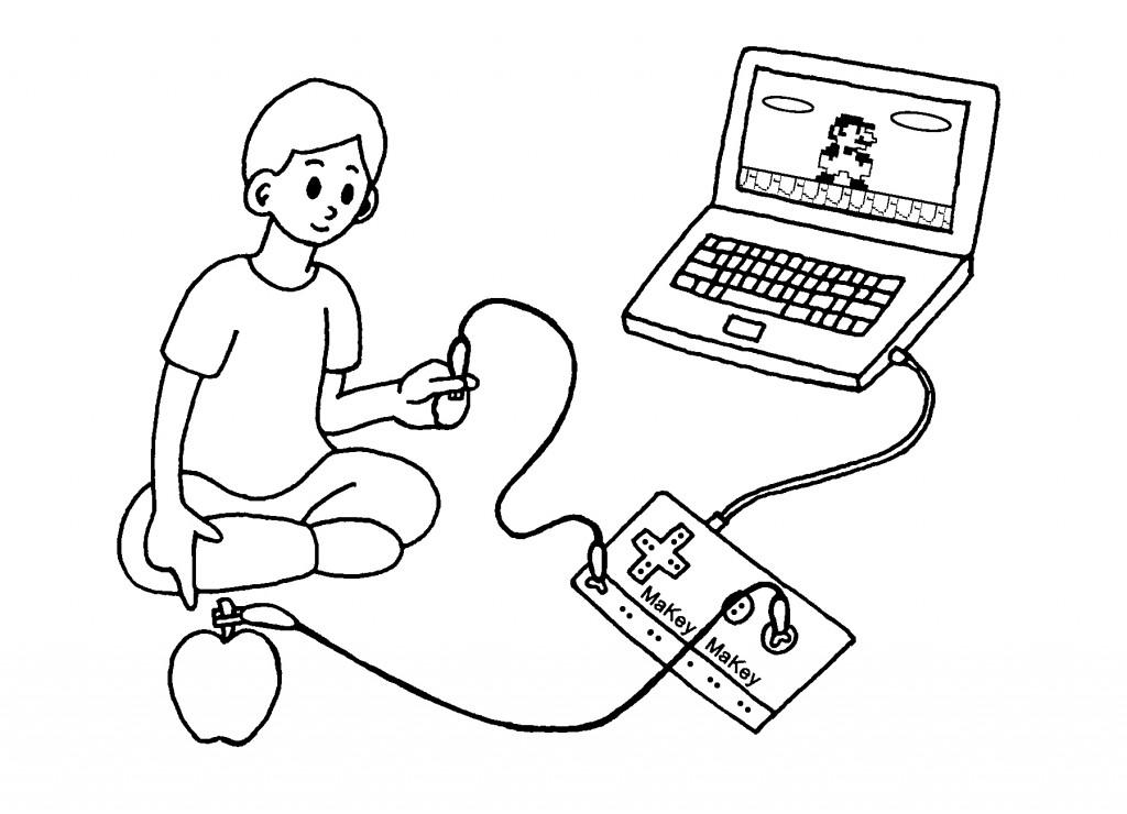 Ein Junge hat an sein MaKey MaKey einen Apfel und einen Laptop angeschlossen
